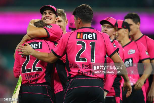 Josh Philippe of the Sixers is embraced by Sean Abbott of the Sixers after winning the Big Bash League match between the Sydney Sixers and the Hobart...