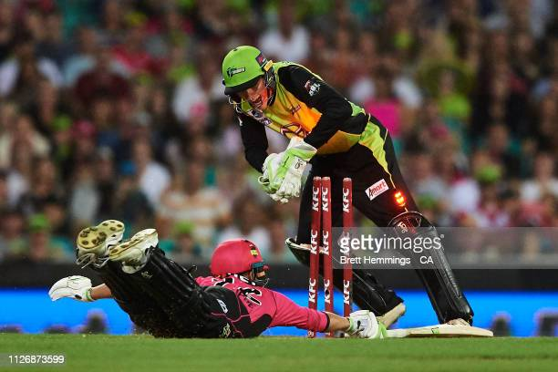 Josh Philippe of the Sixers is run out by Baxter Holt of the Thunder during the Big Bash League match between the Sydney Sixers and the Sydney...