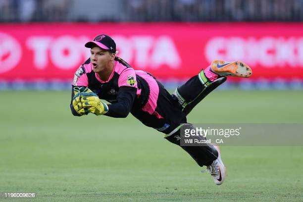 Josh Philippe of the Sixers keeps during the Big Bash League match between the Perth Scorchers and the Sydney Sixers at Optus Stadium on December 26...