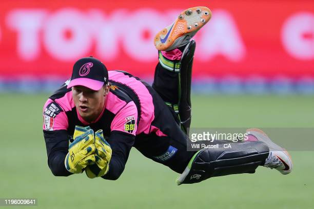 Josh Philippe of the Sixers keeps during the Big Bash League match between the Perth Scorchers and the Sydney Sixers at Optus Stadium on December 26,...