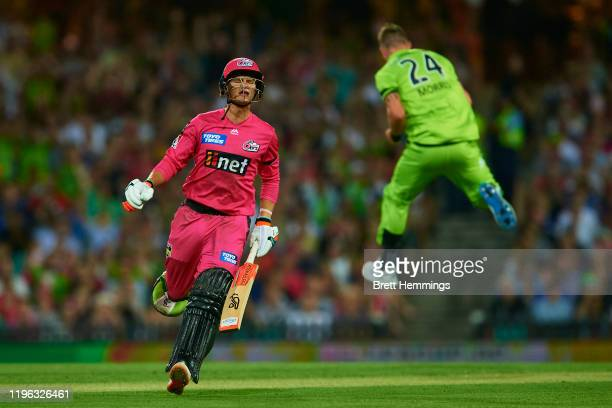 Josh Philippe of the Sixers reacts after being dismissed by Chris Morris of the Thunder during the Big Bash League match between the Sydney Sixers...