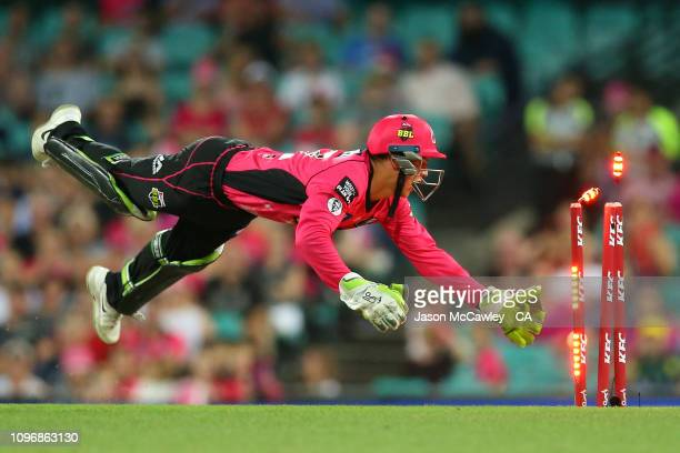 Josh Philippe of the Sixers runs out Jack Prestwidge of the Heat during the Big Bash League match between the Sydney Sixers and the Brisbane Heat at...