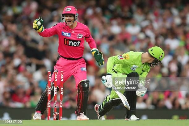 Josh Philippe of the Sixers stumps Matthew Gilkes of the Thunder during the Big Bash League match between the Sydney Sixers and the Sydney Thunder at...