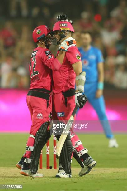 Josh Philippe of the Sydney Sixers and team mate Tom Curran celebrate winning over Adelaide Strikers during the Big Bash League match between the...