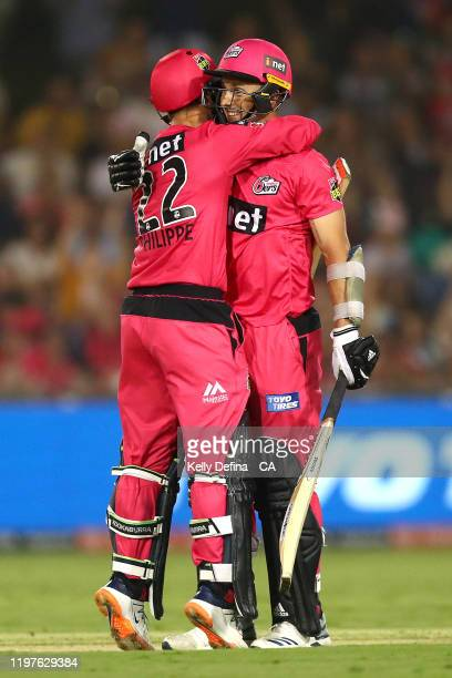 Josh Philippe of the Sydney Sixers and Tom Curran of the Sixers celebrate victory during the Big Bash League match between the Sydney Sixers and the...