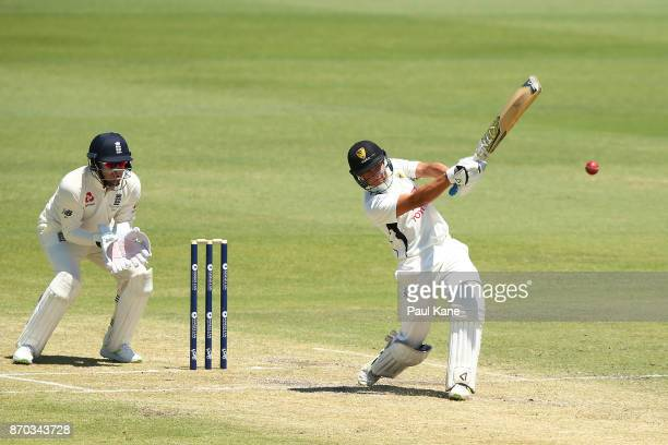 Josh Philippe of the WA XI hits Mason Crane of England to the boundary during day two of the Ashes series Tour Match between Western Australia XI and...