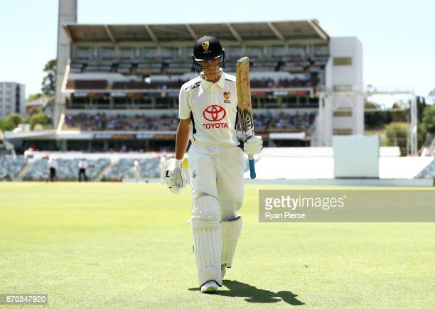 Josh Philippe of Western Australia XI walks from the ground after being dismissed by Mason Crane of England for 88 runs during day two of the Ashes...