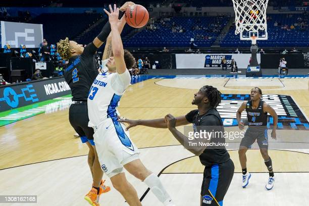 Josh Pierre-Louis of the UC Santa Barbara Gauchos blocks Christian Bishop of the Creighton Bluejays during the second half in the first round game of...