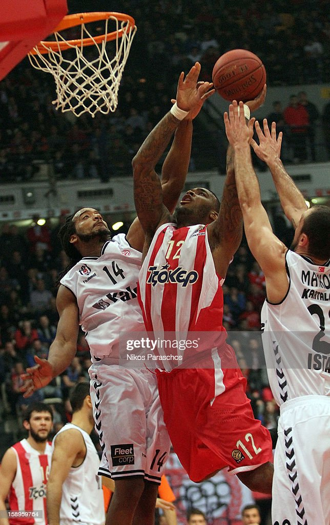 Josh Powell, #12 of Olympiacos Piraeus competes with Randal Falker, #14 of Besiktas JK Istanbul during the 2012-2013 Turkish Airlines Euroleague Top 16 Date 2 between Olympiacos Piraeus v Besiktas JK Istanbul at Peace and Friendship Stadium on January 4, 2013 in Athens, Greece.