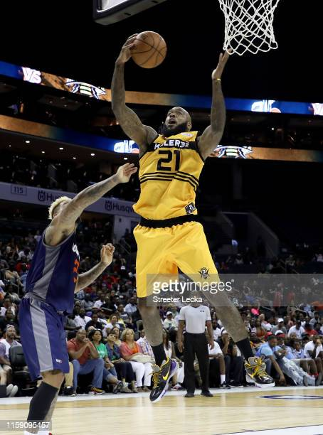 Josh Powell of Killer 3s rebounds the ball against 3's Company during week two of the BIG3 three on three basketball league at Spectrum Center on...