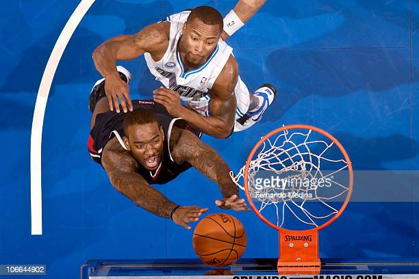 Josh Powell of the Atlanta Hawks shoots against Rashard Lewis of the Orlando Magic on November 8 2010 at the Amway Center in Orlando Florida NOTE TO...