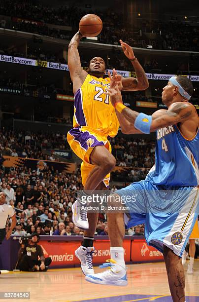 Josh Powell of the Los Angeles Lakers goes up for a shot against Kenyon Martin of the Denver Nuggets at Staples Center on November 21 2008 in Los...