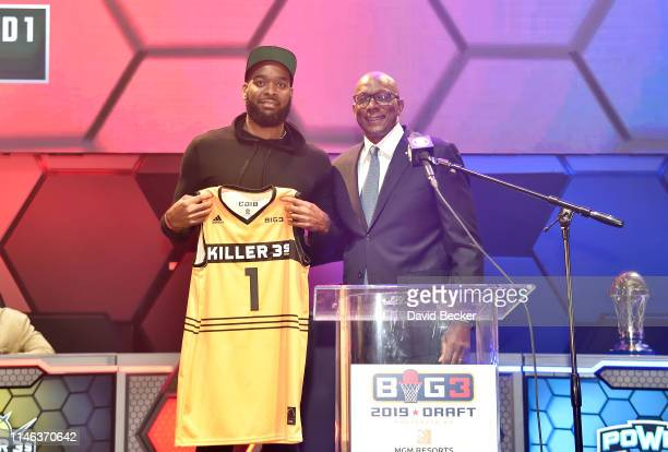 Josh Powell poses with BIG3 Commissioner Clyde Drexler after being drafted at by the Killer 3's in the first round during the BIG3 Draft at the Luxor...