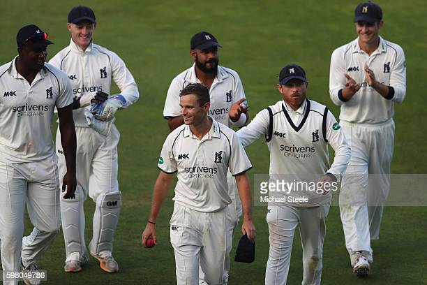 Josh Poysden is congratulated by captain Ian Bell of Warwickshire after finishing with 5 for 53 during day one of the Specsavers County Championship...