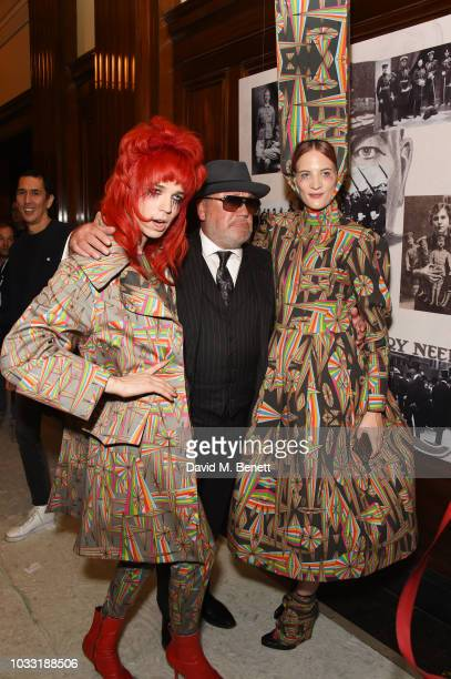 Josh Quinton Ray Winstone and a model pose backstage at the Pam Hogg show during London Fashion Week September 2018 at The Freemason's Hall on...