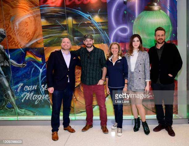 Josh Reader Glossblack Karen Dougherty Buchholz Eve Lindley and Jason Segel attend the Dispatches From Elsewhere mural unveiling at the Comcast...