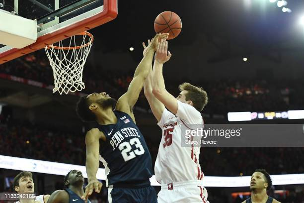 Josh Reaves of the Penn State Nittany Lions blocks a shot by Nate Reuvers of the Wisconsin Badgers during the second half of a game at Kohl Center on...