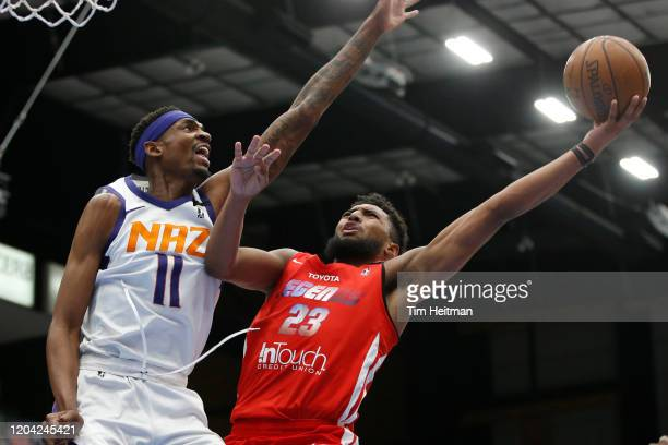 Josh Reaves of the Texas Legends drives against Tariq Owens of the Northern Arizona Suns during the first quarter on February 29, 2020 at Comerica...