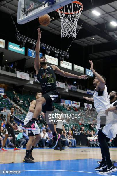Josh Reaves of the Texas Legends drives on Dedric Lawson of the Austin Spurs during the second quarter on December 4th, 2019 at Comerica Center in...
