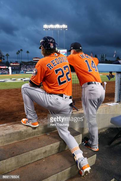 Josh Reddick and manager AJ Hinch of the Houston Astros are seen in the dugout during Game 7 of the 2017 World Series against the Los Angeles Dodgers...