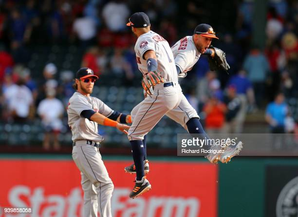 Josh Reddick Carlos Correa and George Springer of the Houston Astros celebrate the 41 win over the Texas Rangers at the Opening Day baseball game at...