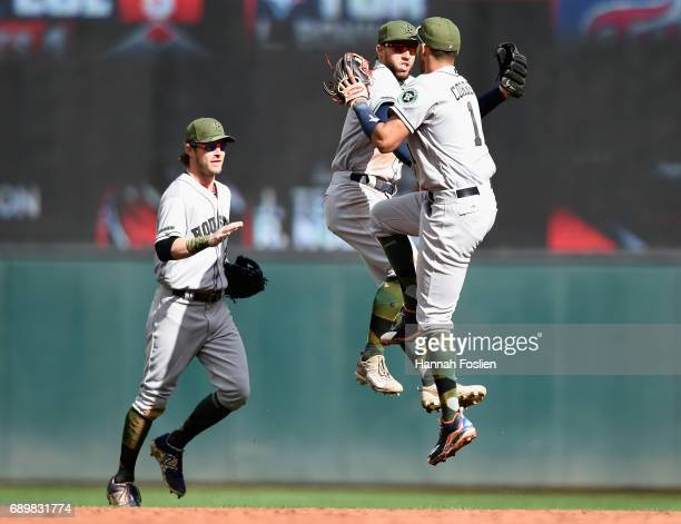 Josh Reddick George Springer and Carlos Correa of the Houston Astros celebrate winning the game against the Minnesota Twins on May 29 2017 at Target...