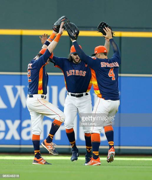 Josh Reddick Jake Marisnick and George Springer of the Houston Astros celebrate after the final out against the Kansas City Royals at Minute Maid...