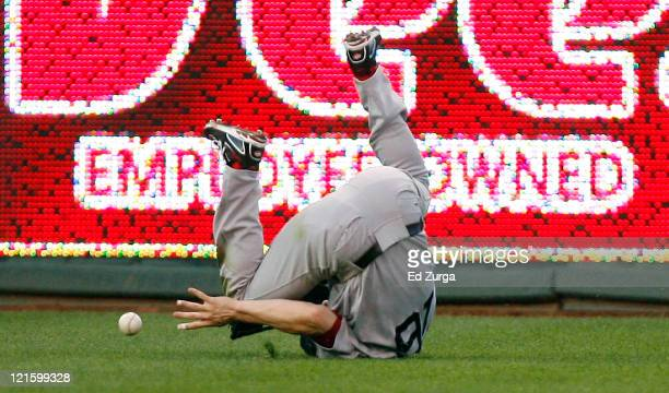 Josh Reddick of the Boston Red Sox tumbles as he reaches out to get control of a ball hit by Alex Gordon of the Kansas City Royals at Kauffman...