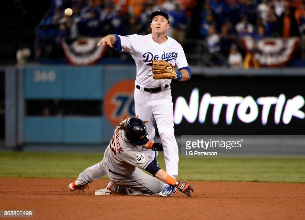 Josh Reddick of the Hosuton Astros is out at second as Chase Utley of the Los Angeles Dodgers throws to first in the top of the seventh inning of...