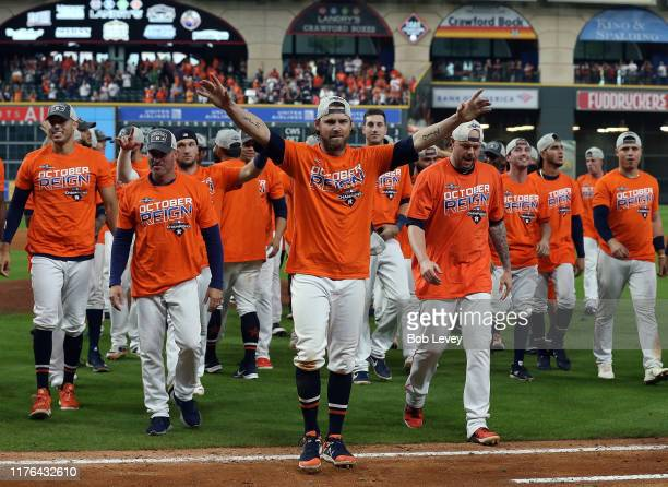 Josh Reddick of the Houston Astros and the team acknowledges the crowd after winning the American League West Division after defeating the Los...