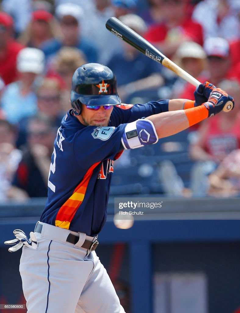 Josh Reddick #22 of the Houston Astros backs away from an inside pitch by Joe Ross #41 of the Washington Nationals during the first inning of a spring training baseball game on March 12, 2017 in West Palm Beach, Florida.