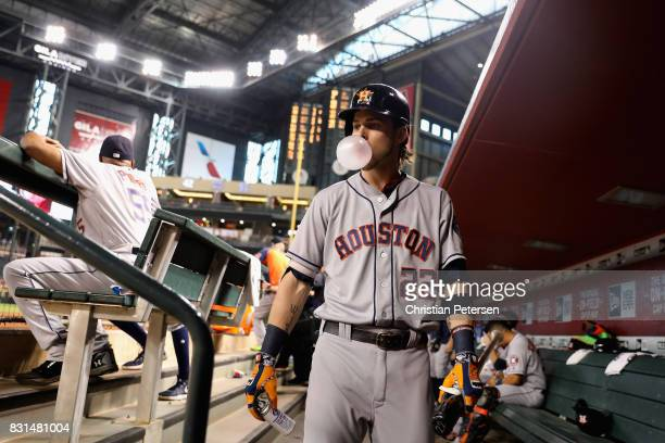 Josh Reddick of the Houston Astros blows a gum bubble as he walks through the dugout before the MLB game against the Arizona Diamondbacks at Chase...