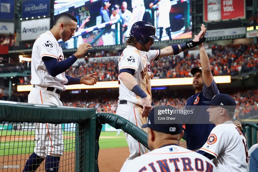 Josh Reddick #22 of the Houston Astros celebrates with teammates after scoring during the fifth inning against the Los Angeles Dodgers in game three of the 2017 World Series at Minute Maid Park on October 27, 2017 in Houston, Texas.
