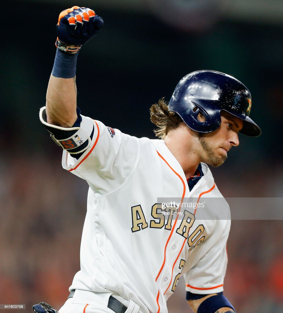 Josh Reddick #22 of the Houston Astros hits a grand slam in the seventh inning against the Baltimore Orioles at Minute Maid Park on April 3, 2018 in Houston, Texas.