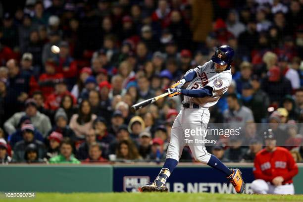 Josh Reddick of the Houston Astros hits a solo home run during the ninth inning against the Boston Red Sox in Game One of the American League...