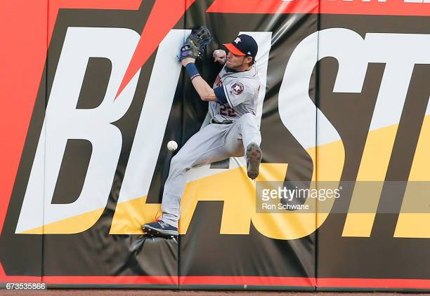 Josh Reddick of the Houston Astros hits the wall going for a ball off the bat of Michael Brantley of the Cleveland Indians during the first inning at...