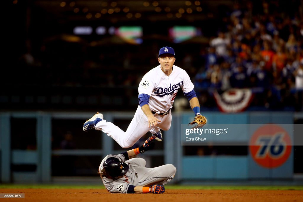 Josh Reddick #22 of the Houston Astros is forced out at second base as Chase Utley #26 of the Los Angeles Dodgers throws to first base during the seventh inning in game six of the 2017 World Series at Dodger Stadium on October 31, 2017 in Los Angeles, California.