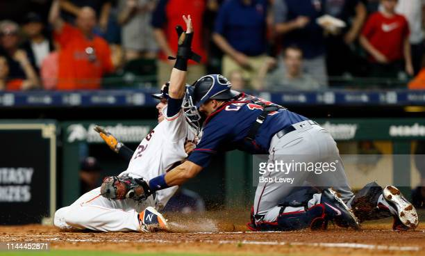 Josh Reddick of the Houston Astros is tagged out by Jason Castro of the Minnesota Twins attempting to score in the fourth inning at Minute Maid Park...