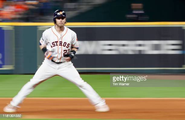 Josh Reddick of the Houston Astros leads off first base in the seventh inning against the Tampa Bay Rays during game five of the American League...