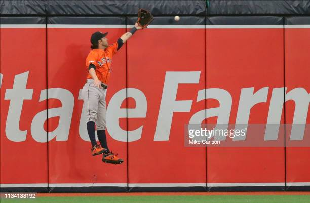 Josh Reddick of the Houston Astros leaps for a hit by Avisail Garcia of the Tampa Bay Rays in the sixth inning of a baseball game at Tropicana Field...