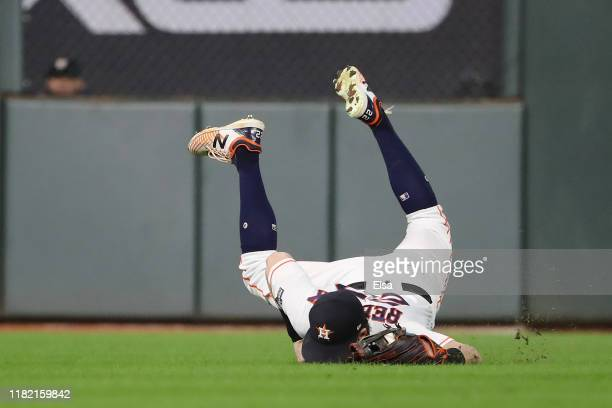 Josh Reddick of the Houston Astros makes a diving catch on a fly ball against the New York Yankees during the sixth inning in game six of the...
