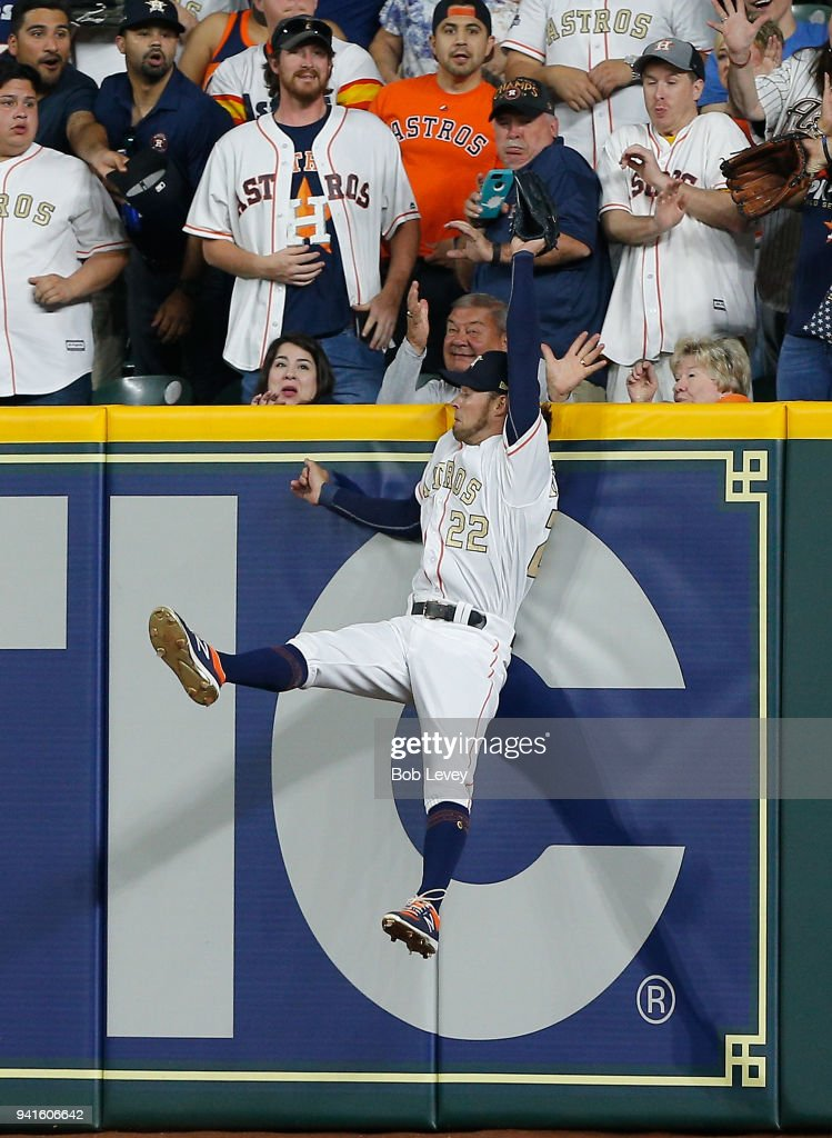 Josh Reddick #22 of the Houston Astros makes a leaping catch at the wall on a fly ball by Trey Mancini #16 of the Baltimore Orioles in the third inning at Minute Maid Park on April 3, 2018 in Houston, Texas.