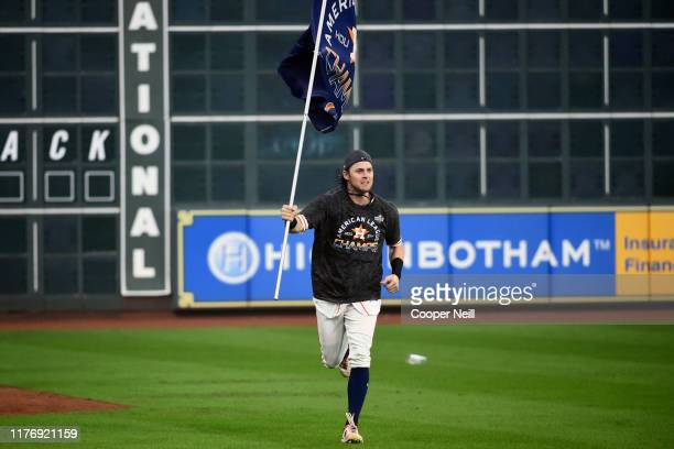 Josh Reddick of the Houston Astros runs a lap around the field after winning the AL pennant with a 6-4 win in Game 6 of the ALCS against the New York...