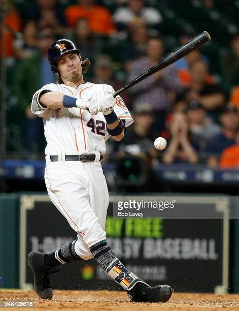 Josh Reddick of the Houston Astros with a check swing single in the tenth inning against the Texas Rangers at Minute Maid Park on April 15 2018 in...