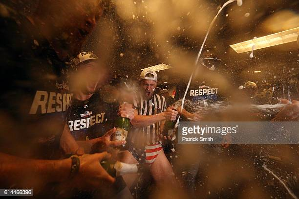 Josh Reddick of the Los Angeles Dodgers celebrates with teammates in the clubhouse after winning game five of the National League Division Series...