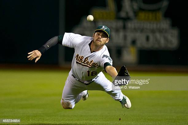 Josh Reddick of the Oakland Athletics catches and then drops a fly ball hit off the bat of Evan Longoria of the Tampa Bay Rays for a single during...