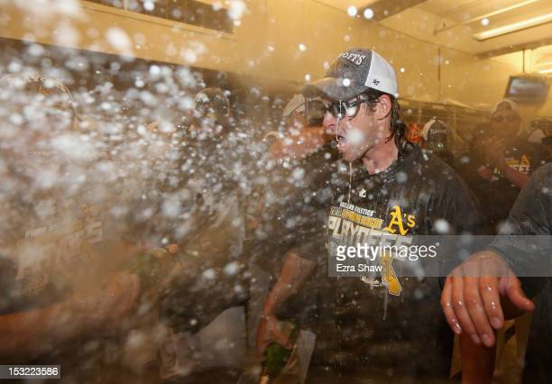 Josh Reddick of the Oakland Athletics celebrates in the lockerroom after the Athletics beat the Texas Rangers to clinch a playoff spot at O.co...
