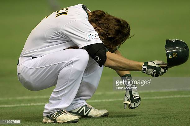 Josh Reddick of the Oakland Athletics reacts to getting out in the sixth innings against the Seattle Mariners during the MLB Opening Series game...