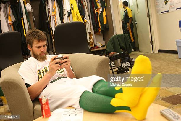 Josh Reddick of the Oakland Athletics relaxes in the clubhouse prior to the game against the Seattle Mariners at Oco Coliseum on June 15 2013 in...