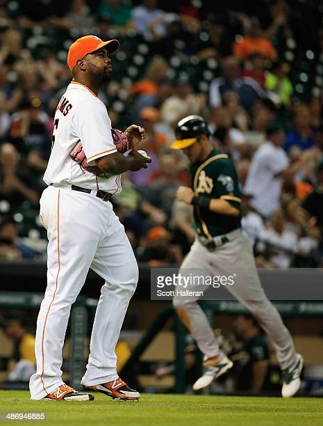 Josh Reddick of the Oakland Athletics runs home in the ninth inning after Jerome Williams of the Houston Astros allowed a three run home run during...